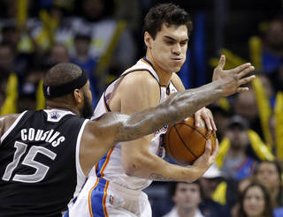 Oklahoma City's Steven Adams (12) grabs a rebound from Sacramento's DeMarcus Cousins (15) during the NBA game between the Oklahoma City Thunder and the Sacramento Kings at the Chesapeake Energy Arena, Sunday, Jan. 19, 2014. Photo by Sarah Phipps, The Oklahoman
