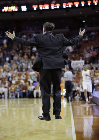 Oklahoma State coach Travis Ford jumps as he yells to his players during the first half on an NCAA college basketball game against Texas, Tuesday, Feb. 11, 2014, in Austin, Texas. (AP Photo/Eric Gay)