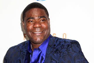 """FILE - In this April 9, 2014 file photo, actor Tracy Morgan attends the FX Networks Upfront premiere screening of """"Fargo"""" at the SVA Theater in New York. Morgan is struggling more than two months after he was injured in a motor vehicle crash that left a fellow comedian dead, his lawyer said Monday, Aug. 11, 2014. (Photo by Greg Allen/Invision/AP, File)"""