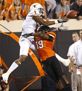 Oklahoma State's Brodrick Brown (19) is called for pass interference on Texas' Mike Davis (1) during a college football game between Oklahoma State University (OSU) and the University of Texas (UT) at Boone Pickens Stadium in Stillwater, Okla., Saturday, Sept. 29, 2012. Photo by Bryan Terry, The Oklahoman BRYAN TERRY