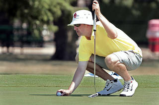 Ryan Munson lines up a putt at the 37th annual Westwood Invitational Golf Tournament. PHOTOs BY STEVE SISNEY, THE OKLAHOMAN
