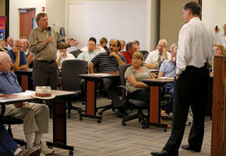 Steve Byas, of Norman, asks a question to Rep. Tom Cole, R-Moore, during a town hall meeting at Rose State College in Midwest City, Tuesday, September 3, 2013. Photo by Bryan Terry, The Oklahoman BRYAN TERRY - THE OKLAHOMAN