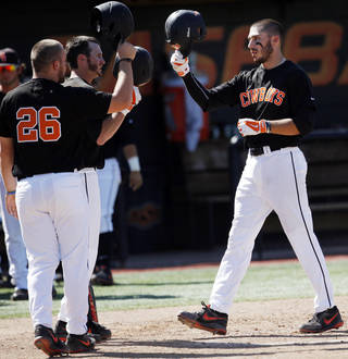 Oklahoma State base runner Tanner Krietemeier, right, is congratulated by teammates after hitting a homerun against Arizona State earlier this month. Photo by KT King, The Oklahoman