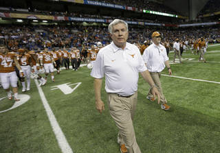 Texas coach Mack Brown walks onto the field following the Valero Alamo Bowl NCAA college football game against Oregon, Monday, Dec. 30, 2013, in San Antonio. Oregon won 30-7. (AP Photo/Eric Gay)