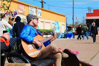 Ethan Schlecht was among several artists performing at Saturday's Better Block OKC at Farmers Public Market. Millennials led the way in re-introducing Oklahoma City residents to Farmers Public Market just south of downtown by staging a Better Block OKC festival featuring live music, food trucks, pop-up shops and permanent improvements to area that included directional signage, curbside parking spots and a fresh coat of paint. Photo provided by Eric Dryer