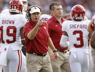 REACTION: Oklahoma coach Bob Stoops reacts after a touchdown during a college football game between the University of Oklahoma Sooners (OU) and the Texas Christian University Horned Frogs (TCU) at Amon G. Carter Stadium in Fort Worth, Texas, Saturday, Dec. 1, 2012. Oklahoma won 24-17. Photo by Bryan Terry, The Oklahoman