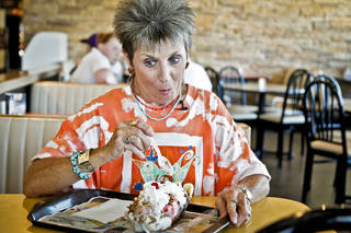 Patti Dobelbower reacts after trying her very first banana split at Braum's. CHRIS LANDSBERGER - THE OKLAHOMAN