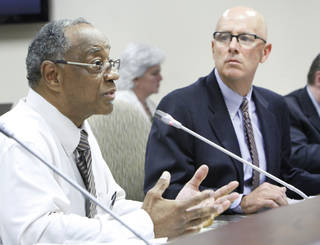 Dr. Gregory Keith Morton III appears Thursday at a disciplinary hearing alleging sexual misconduct as board attorney Randy Sullivan looks on. Photo By David McDaniel, The Oklahoman