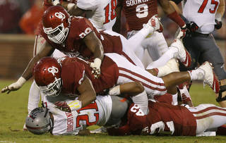 Oklahoma's Matthew Romar (92) and Chuka Ndulue (98) bring down Texas Tech's DeAndre Washington (21) during a college football game between the University of Oklahoma Sooners (OU) and the Texas Tech Red Raiders at Gaylord Family-Oklahoma Memorial Stadium in Norman, Okla., on Saturday, Oct. 26, 2013. Oklahoma won 38-30. Photo by Bryan Terry, The Oklahoman