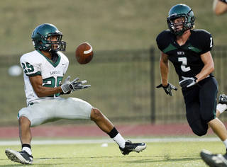 Edmond Santa Fe's Dale Jefferson, left, makes a touchdown catch in front of Norman North's Keaton Haney during an Aug. 16 scrimmage in Moore. Photo by Nate Billings, The Oklahoman