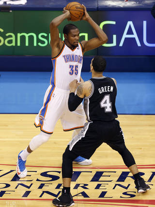 Oklahoma City's Kevin Durant (35) looks to pass as San Antonio's Danny Green (4) defends during Game 6 of the Western Conference Finals in the NBA playoffs between the Oklahoma City Thunder and the San Antonio Spurs at Chesapeake Energy Arena in Oklahoma City, Saturday, May 31, 2014. Photo by Nate Billings, The Oklahoman