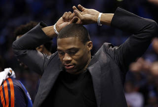Thunder's Russell Westbrook watches the closing seconds of the second half of an NBA basketball game where the Oklahoma City Thunder were defeated 95-93 by the Brooklyn Nets at the Chesapeake Energy Arena in Oklahoma City, on Thursday, Jan. 2, 2014.. Photo by Steve Sisney, The Oklahoman