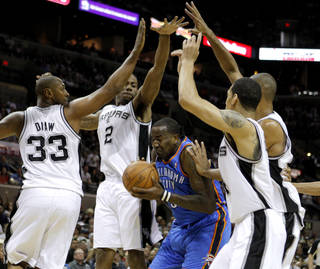 NBA BASKETBALL: Oklahoma City's Kendrick Perkins (5) gets caught between San Antonio's Boris Diaw (33), Kawhi Leonard (2), Daniel Green (4), and Tim Duncan (21) during Game 2 of the Western Conference Finals between the Oklahoma City Thunder and the San Antonio Spurs in the NBA playoffs at the AT&T Center in San Antonio, Texas, Tuesday, May 29, 2012. Photo by Bryan Terry, The Oklahoman