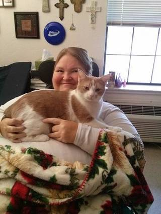 Grace Living Center Norman resident Babette Blanchard cozies up to Sam. The friendly feline enjoys spending time with residents, staff and visitors at the home. PHOTO PROVIDED BY GRACE LIVING CENTER NORMAN