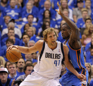 Oklahoma City's Serge Ibaka (9) defends Dirk Nowitzki (41) of Dallas during game 1 of the Western Conference Finals in the NBA basketball playoffs between the Dallas Mavericks and the Oklahoma City Thunder at American Airlines Center in Dallas, Tuesday, May 17, 2011. Photo by Bryan Terry, The Oklahoman