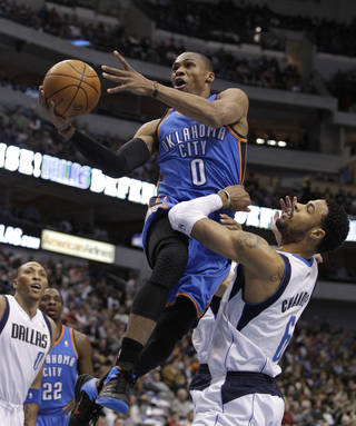 Oklahoma City Thunder guard Russell Westbrook leaps past Dallas Mavericks center Tyson Chandler (6) for a shot in the first half of an NBA basketball game, Thursday, Jan. 6, 2011, in Dallas. (AP Photo/Tony Gutierrez)