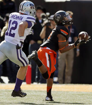 Oklahoma State's Josh Stewart (5) drops a pass as Kansas State's Ty Zimmerman (12) pursues in the second quarter during a college football game between the Oklahoma State University Cowboys (OSU) and the Kansas State University Wildcats (KSU) at Boone Pickens Stadium in Stillwater, Okla., Saturday, Oct. 5, 2013. Photo by Nate Billings, The Oklahoman