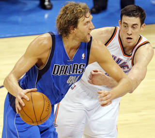 OKLAHOMA CITY ARENA: Nick Collison (4) of Oklahoma City defends Dirk Nowitzki (41) of Dallas in the second half during game 3 of the Western Conference Finals of the NBA basketball playoffs between the Dallas Mavericks and the Oklahoma City Thunder at the OKC Arena in downtown Oklahoma City, Saturday, May 21, 2011. Dallas won, 93-87. Photo by Nate Billings, The Oklahoman ORG XMIT: KOD