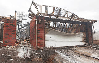 This house in Midwest City was destroyed Thursday by wildfires in the area. PHOTO BY CHRIS LANDSBERGER, THE OKLAHOMAN