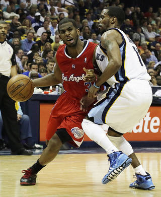 Los Angeles Clippers' Chris Paul, (3) left, moves against Memphis Grizzlies' Mike Conley during the first half of Game 3 in a first-round NBA basketball playoff series, in Memphis, Tenn., Thursday, April 25, 2013. (AP Photo/Danny Johnston) ORG XMIT: TNDJ104