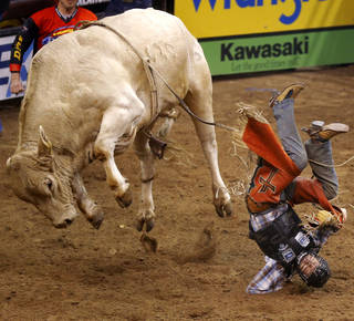 Brant Atwood hits the ground after finishing his ride on Blonde Bomber during the WinStar World Casino Invitational PBR bull riding event at Chesapeake Energy Arena in Oklahoma City, Saturday, Jan. 26, 2013. Photo by Bryan Terry, The Oklahoman