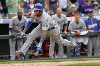 Los Angeles Dodgers' Matt Kemp slides into home to score on a hit by Dee Gordon during the ninth inning of a baseball game against the Colorado Rockies on Wednesday, May 2, 2012 in Denver. The Rockies won 8-5. (AP Photo/Barry Gutierrez) ORG XMIT: COBG113