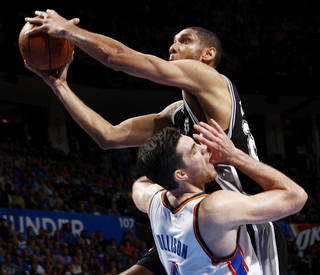 ALTERNATE CROP: Oklahoma City's Nick Collison (4) is called for the blocking foul on San Antonio's Tim Duncan (21) during an NBA basketball game between the Oklahoma City Thunder and the San Antonio Spurs at Chesapeake Energy Arena in Oklahoma City, Thursday, April 4, 2013. Photo by Nate Billings, The Oklahoman