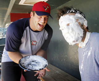 Kevin Richardson, left, laughs after demonstrating his pie-in-the face technique on fellow RedHawk Royce Huffman. Photo by Nate Billings, The Oklahoman