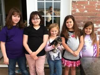 From left to right: sisters Trinity and Antonia Candelaria; an unidentified neighborhood friend; and Emily and Luci Conatzer. Antonia Candelaria and Emily Conatzer died May 20 at Plaza Towers Elementary School after sheltering in a hallway. Photo provided