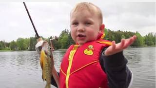 In a video from May 29, 2011, 3-year-old Teddy unknowingly catches a small fish while out on the lake with his dad. (YouTube screenshot)