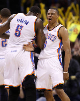Oklahoma City Thunder guard Russell Westbrook, right, celebrates with teammate Kendrick Perkins, left, after a basket in the fourth quarter of an NBA basketball game against the Portland Trail Blazers, in Oklahoma City, Sunday, March 27, 2011. Oklahoma City won 99-90. (AP Photo/Sue Ogrocki) ORG XMIT: OKSO107