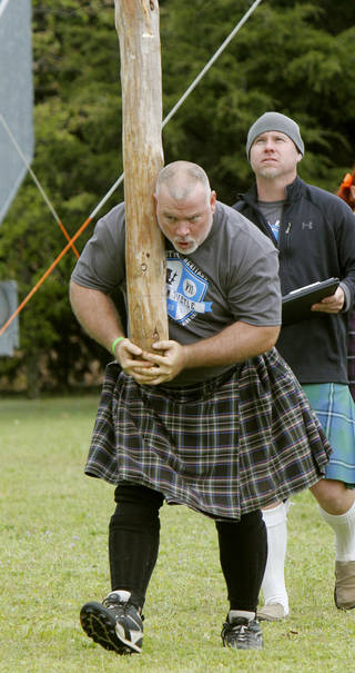 Kyle Fuller, of Arlington, Texas, competes in the caber toss during the 2013 Iron Thistle Scottish Heritage Festival in Yukon. Photo by Paul Hellstern, The Oklahoman Archives PAUL HELLSTERN -