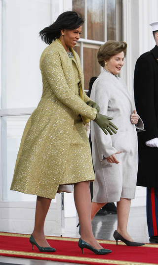 Michelle Obama, left, walks out of the White House before going to the swearing-in. Ap photo
