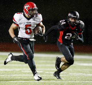 Mustang's Frankie Edwards, left, runs for a touchdown past Westmoore's Blake Martin during a 2011 in Moore. Photo by Bryan Terry, The Oklahoman Archives