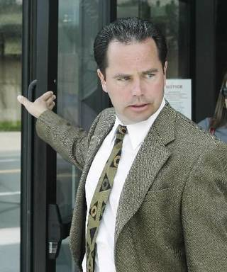 klahoma County Commissioner Brent Rinehart leaves the federal courthouse following a court appearance in Oklahoma City, Thursday, July 31, 2008. (AP Photo)