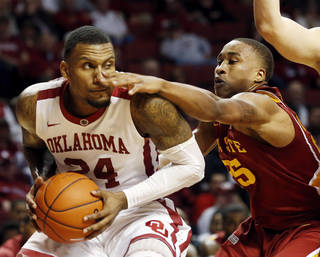 Oklahoma's Romero Osby (24) and Iowa State Cyclone's Tyrus McGee (25) tangle as the University of Oklahoma Sooners (OU) men play the Iowa State Cyclones in NCAA, college basketball at Lloyd Noble Center on Saturday, March 2, 2013 in Norman, Okla. Photo by Steve Sisney, The Oklahoman