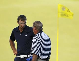 Dustin Johnson talks with rules official David Price on the 18th hole during the final round of the PGA Championship golf tournament Sunday, Aug. 15, 2010, at Whistling Straits in Haven, Wis. Johnson was later assessed a two-stroke penalty for grounding his club in a hazard on the hole.(AP Photo/Charlie Neibergall) ORG XMIT: PGA162