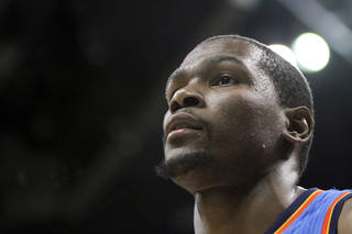 Oklahoma City Thunder forward Kevin Durant leaves the court after scoring 24 points in the team's 103-90 victory over the Denver Nuggets in an NBA basketball game Thursday, March 15, 2012, in Denver. (AP Photo/Barry Gutierrez) ORG XMIT: COBG109