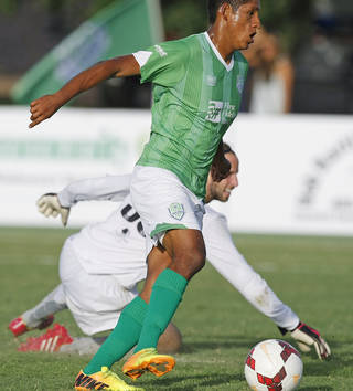 Energy FC midfielder Dan Delgado (13) dribbles the ball by Riverhounds FC goalkeeper Mike Lisch (3) to score a goal during a USL Pro soccer game between OKC Energy FC and Pittsburgh Riverhounds FC at Pribil Stadium in Oklahoma City on July 12, 2014. Photo by KT King, The Oklahoman