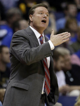 Kansas head coach Bill Self is seen on the sidelines during the first half of a second-round game against Eastern Kentucky in the NCAA college basketball tournament Friday, March 21, 2014, in St. Louis. (AP Photo/Jeff Roberson)