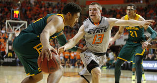 Oklahoma State's Phil Forte (13) defends Baylor's Ish Wainright (24) during an NCAA college basketball game between Oklahoma State University (OSU) and Baylor at Gallagher-Iba Arena in Stillwater, Okla., Saturday, Feb. 1, 2014. Baylor won 76-70. Photo by Bryan Terry, The Oklahoman