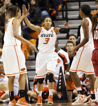 Oklahoma State's Tiffany Bias (3) celebrates with Kendra Suttles (31), left, and Toni Young (15) after a play during the Bedlam women's college basketball game between Oklahoma State University and the University of Oklahoma at Gallagher-Iba Arena in Stillwater, Okla., Saturday, Feb. 23, 2013. OSU beat OU, 83-62. Photo by Nate Billings, The Oklahoman