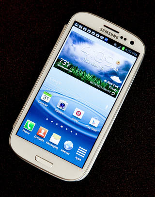 Samsung's Galaxy S III phone is shown. AP PHOTO Bebeto Matthews - AP