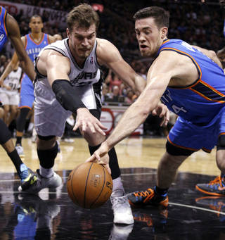 Oklahoma City's Nick Collison (4) and San Antonio's Tiago Splitter (22) fight for a loose ball during Game 1 of the Western Conference Finals in the NBA playoffs between the Oklahoma City Thunder and the San Antonio Spurs at the AT&T Center in San Antonio, Monday, May 19, 2014. Photo by Sarah Phipps, The Oklahoman