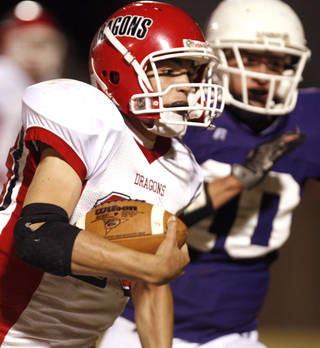 Purcell quarterback Cole Swayze (23) gets past Bethany defender Nick Branscum (10) during the first half of the high school football game between Bethany and Purcell, Friday, Oct. 24, 2008, at Bethany Stadium in Bethany, Okla.. PHOTO BY SARAH PHIPPS, THE OKLAHOMAN