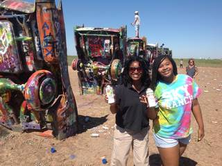 Me and my eldest have fun decorating at the Cadillac Ranch. Photo by Carla Meadows