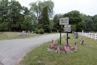The entrance to the cemetery in Lowellville, Ohio is shown. AP Photo