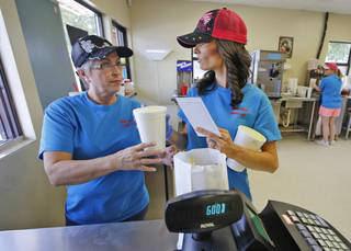 Dairy Boy Drive In owner Karen Bratcher, left, and her daughter, Bobbie Sue Tallent finish an order at the family owned drive in located on SW 3rd St in Minco Thursday August 14, 2014. Photo By Steve Gooch, The Oklahoman