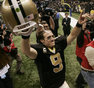 New Orleans Saints Drew Brees celebrates after their NFL football game against the New England Patriots, Monday, Nov. 30, 2009, in New Orleans. The Saints defeated the Patriots 38-17 to remain undefeated at 11-0. AP Photo