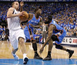 JOSE BAREA: Jose Juan Barea (11) of Dallas goes past Oklahoma City's Nate Robinson (3) and James Harden (13) during game 1 of the Western Conference Finals in the NBA basketball playoffs between the Dallas Mavericks and the Oklahoma City Thunder at American Airlines Center in Dallas, Tuesday, May 17, 2011. Photo by Bryan Terry, The Oklahoman BRYAN TERRY